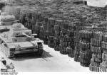 Near-complete German Panzer III tanks at a factory, Germany, Oct 1942; note stockpile of tank tracks