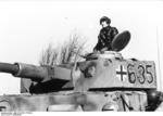 Tank commander and his Panzer IV tank of German 12th SS Panzer Division