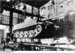 A newly bulit Tiger I heavy tank being loaded onto a rail car at the Henschel factory in Kassel, Germany, 1942-1944