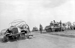 Crew of a German Tiger I heavy tank resting beside a road during Battle of Kursk, Russia, Jul 1943, photo 1 of 2
