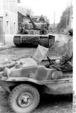 Tiger I heavy tank of the German 1st SS Division Leibstandarte SS Adolf Hitler and Schwimmwagen vehicle in Morgny, France, 7 Jun 1944, photo 1 of 3