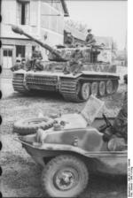 Tiger I heavy tank of the German 1st SS Division Leibstandarte SS Adolf Hitler and Schwimmwagen vehicle in Morgny, France, 7 Jun 1944, photo 2 of 3