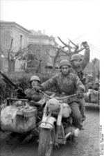 German paratroopers with R75 motorcycle, Italy, 1943-1944; note MG 42 machine gun mounted on the side car