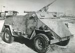 Scout Car S1 (American) at rest, date unknown; note Browning M2 machine gun on top and two Browning M1921 machine guns in rear