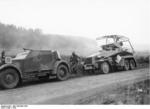 German SdKfz. 13 and SdKfz. 232 armored vehicles during military exercises, fall 1936; note German soldier wearing gas mask