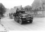 German SdKfz. 10/4 half-track vehicles with 2-cm flak guns driving through the village of Gourgançon, Marne, France, May 1940