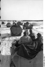 German SdKfz. 251 halftrack vehicles and Panzer IV tanks in Russia, 21 Mar 1944, photo 1 of 2