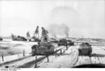 German SdKfz. 251 halftrack vehicles and Panzer IV tanks in Russia, 21 Mar 1944, photo 2 of 2