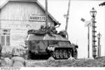German SdKfz. 251/1 halftrack vehicle at a rail crossing, Aiviekstes, Latvia, Jun 1941