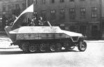 Polish insurgent fighters with captured German SdKfz. 251 halftrack vehicle, Warsaw, Poland, 14 Aug 1944, photo 1 of 6; Tamka Street; note captured MP 40 submachine gun