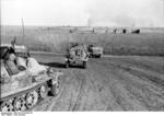 SdKfz. 250, SdKfz. 250/3, and SdKfz. 251 halftrack vehicles of the German 23rd Panzer Division on the move in Southern Russia, 21 Jun 1942