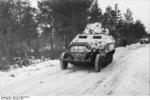 SdKfz. 251 halftrack vehicles in snowy terrain, Russia, Oct 1941, photo 2 of 4; note PaK 36 gun mounted on top of the vehicle
