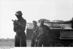 German anti-aircraft gunners near a SdKfz. 251 halftrack vehicle for field medics, Russia, Jun 1941, photo 1 of 2
