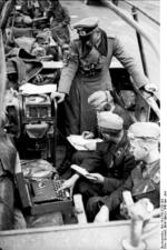 German General Heinz Guderian in a SdKfz. 251/3 halftrack vehicle, France, May 1940, photo 1 of 6; note early 3-rotor Enigma machine