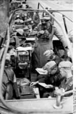 German General Heinz Guderian in a SdKfz. 251/3 halftrack vehicle, France, May 1940, photo 2 of 6; note early 3-rotor Enigma machine
