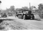 German SdKfz. 6 half-track vehicle towing a howitzer and carrying troops in Poland, Sep 1939
