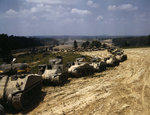 A column of M4 Sherman, M3 Grant, and M3 Stuart tanks in training maneuvers, Fort Knox, Kentucky, United States, Jun 1942