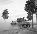 Sherman tank of 24th Lancers, UK 8th Armored Brigade, near St Leger, France, 11 Jun 1944