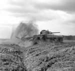 Sherman Crab flail tank under test with the UK 79th (Experimental) Armored Division Royal Engineers, 27 Apr 1944