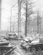 T-34-85 tank and SU-100 tank destroyer of Soviet 1st Guards Tank Army outside of Berlin, Germany, 30 Apr 1945