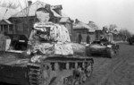 Soviet T-26 tanks in a Russian village, 10 Oct 1941