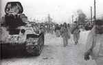 T-34 tank and infantry of Soviet 12th Armored Corps in Rossosh, Russia, 16 Jan 1943