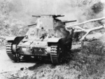 Japanese Type 95 Ha-Go light tank knocked out by Australian anti-tank fire during Battle of Muar in Malaya, late Jan 1942