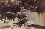 Chinese soldier posing with a captured Japanese Type 97 Shinhoto Chi-Ha medium tank, post war