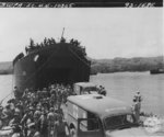 LST-68 at Oro Bay, New Guinea, with US Marine casualties returning from Cape Gloucester, New Britain being assisted into WC54 ambulances, 8 Jan 1944