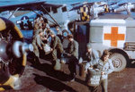 Marmite cans with blood collected from rear echelon troops in England, United Kingdom were being transferred from Dodge WC54 Ambulance to waiting Noorduyn UC-64A Norseman for air transport to Normandy