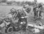 Welbike motorcycle being assembled in the field, date unknown