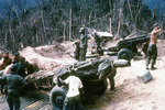 Men of US 3rd Marine Division setting up two M101 105mm howitzers during the construction of a mountain-top fire base, Vietnam, 1 Jun 1968