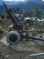 Men of US 3rd Marine Division preparing to load a round into their M101 105mm howitzer, Vietnam, 1 Jun 1968