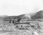 United States Army 105mm Howitzer M2A1 firing, Korea, 22 Jul 1950