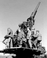 120 mm Gun M1 anti-aircraft weapon manned by men of Battery D, US 36th Anti-aircraft Artillery Gun Battalion during training, Fort George G. Meade, Odenton, Maryland, United States, Feb 1953