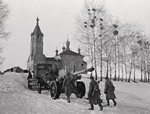 Soviet A-19 field gun being towed by a tractor in the village of Izvekova near Vyazma, Russia, 1 Mar 1943