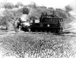 Tractor of 196th Field Artillery of US 8th Army towing a 155 mm Howitzer M1 at Tari-Gol, Korea, 8 Apr 1951