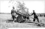 German soldiers camouflaging a 15 cm NbW 41 rocket launcher, Soviet Union, fall 1943