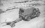 37 mm Gun M3 being towed by a truck, circa 1941