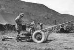General Frank E. Lowe inspecting a captured Soviet M-42 anti-tank gun near Miryang, Korea, 6 Sep 1950