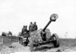 German 7.5 cm PaK 40 anti-tank gun being towed by SdKfz. 10 half-track vehicle, Vitebsk, Russia, Jun 1944