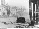 German 7.5 cm PaK 40 anti-tank gun and its crew fighting in the streets of Warsaw, Poland during the Warsaw Uprising, 11 Sep 1944; note heavily damaged buildings