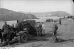 German Army 8.8 cm FlaK 36 gun being mounted onto its carriage, southern France, 1942, photo 3 of 3