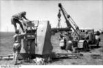 German troops changing the barrel of an 8.8 cm FlaK gun, Bir al Hakim, Tunisia, North Africa, Jun 1942