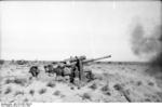 8.8 cm FlaK gun firing at Bir al Hakim, Jun 1942; note General Rommel