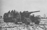 US Army M4 High Speed Tractor towing a captured German 8.8 cm FlaK gun, 1944