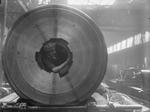 Female worker cleaning the rifling of a BL 15 in gun, Coventry Ordnance works, England, United Kingdom, 1914-1918