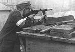 Polish resistance fighter with Blyskawica submachine gun during the Warsaw Uprising, Powisle district, Warsaw, Poland, Aug 1944