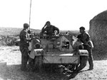 Universal Carrier Mk 1 of Australian 6th Division Cavalry in North Africa, Feb 1941; note Boys anti-tank rifle and a radio set on the Universal Carrier