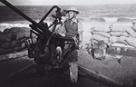 R. K. Bryant of 8 Battery, Australian 2/rd Light Anti-Aircraft Regiment manning an Italian-made Breda Model 35 anti-aircraft gun, Derna, Libya, Mar 1941